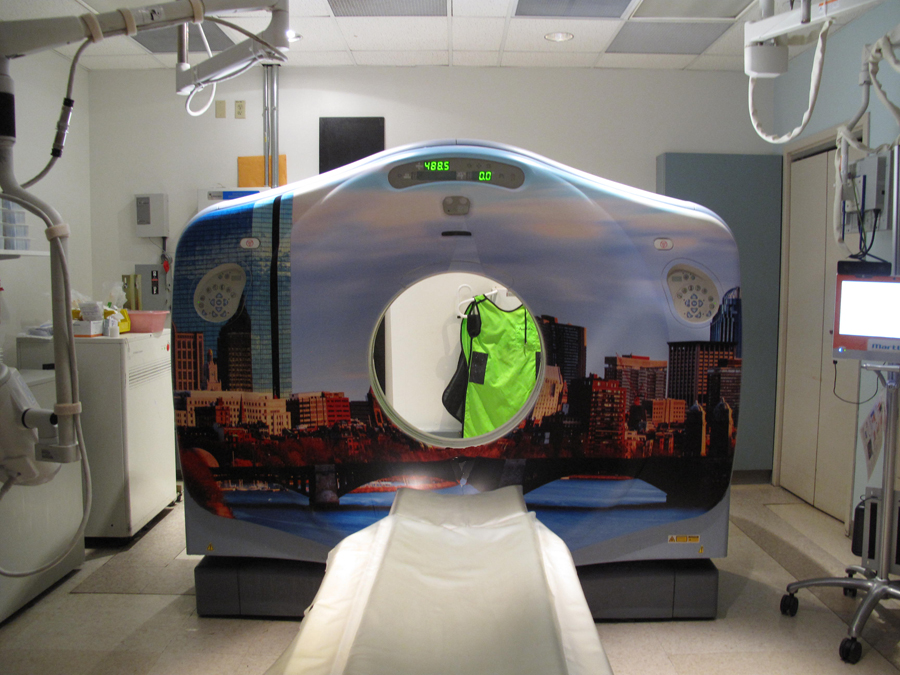 CT scanner with a Boston skyline theme, looking across the Charles River side