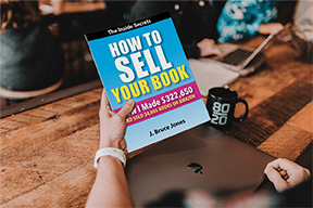 Person holding How to Sell Your Book 4 72